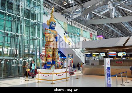 Large Yaksha statue in Suvarnabhumi Airport lobby in Bangkok, Thailand. - Stock Photo