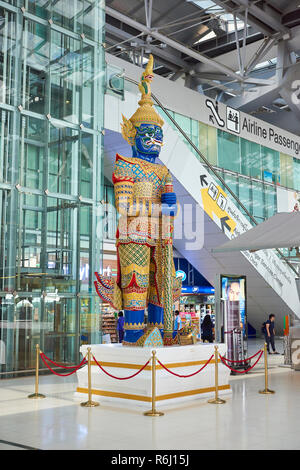 Large Yaksha statue in Suvarnabhumi Airport lobby in Bangkok, Thailand. - Stock Photo