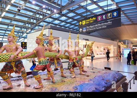 Statues representing the Hindu Churning of the Milk story in Suvarnabhumi Airport lobby in Bangkok, Thailand. - Stock Photo