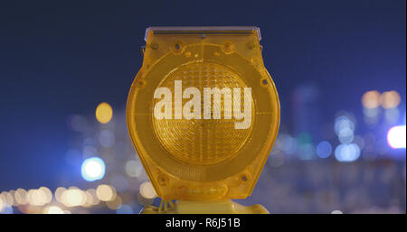 Safety Caution yellow light in the city at night - Stock Photo
