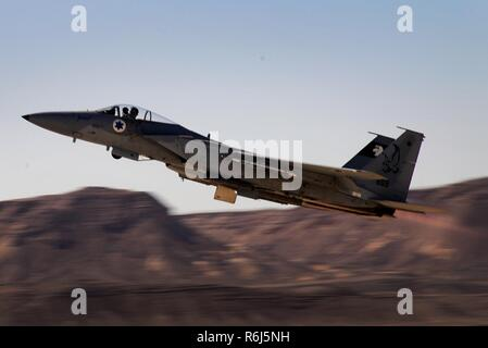 An Israeli F-15C Buzz launches for a sortie in support of exercise Juniper Falcon May 7, at Uvda Air Base, Israel. Juniper Falcon 17 represents the combination of several bi-lateral component/ Israeli Defense Force exercises that have been executed annually since 2011. These exercises were combined to increase joint training opportunities and capitalize on transportation and cost efficiencies gained by aggregating forces. - Stock Photo