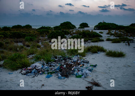 Litter on a tropical uninhabited island in the Indian Ocean - Stock Photo