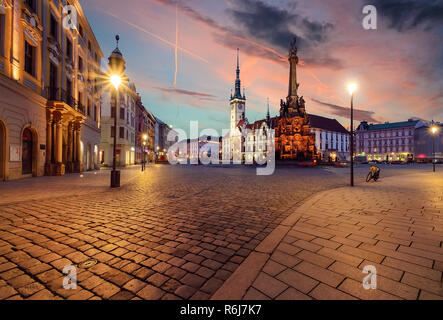 Town hall and Holy Trinity Column in Olomouc, Czech Republic during sunset. - Stock Photo