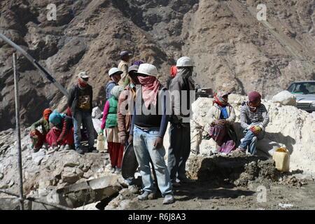 Construction workers building roads in Kinnaur, Himachal Pradesh, India - Stock Photo