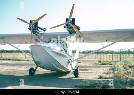 Light twin-engine amphibious aircraft at the airport - Stock Photo