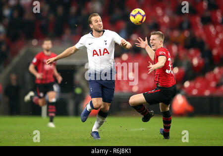 Tottenham Hotspur's Harry Kane (left) and Southampton's Matt Targett battle for the ball during the Premier League match at Wembley Stadium, London. - Stock Photo