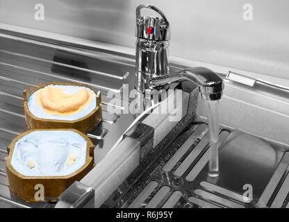 manufacture of molds for dentures in laboratory, water wash faucet mixer - Stock Photo