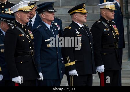 Members of the U.S. Joint Service Chiefs stand at attention outside Washington National Cathedral following the State Funeral of former president George H.W. Bush December 5, 2018 in Washington, DC. Bush, the 41st President, died in his Houston home at age 94. Standing from left to right are: Chairman of the Joint Chiefs Gen. Joseph Dunford, Vice Chairman Paul J. Selva, Army Chief General Mark A. Milley and Marine Corps Chief General Robert B. Neller. - Stock Photo
