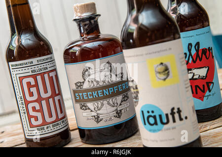 Kassel, Germany. 22nd Nov, 2018. Craft Beer bottles with the imprints 'Steckenpferd', 'läuft', 'gut sud' and 'Kellerkind' are placed on the counter in the Braumanufaktur Steckenpferd. (to dpa 'Successful in the niche - Craft beer brewers assert themselves on the market' of 06.12.2018) Credit: Swen Pförtner/dpa/Alamy Live News - Stock Photo