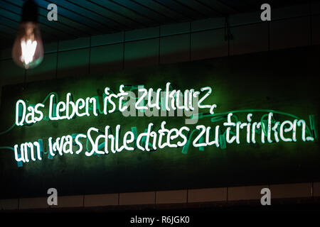 Kassel, Germany. 22nd Nov, 2018. 'Life is too short to drink anything bad' is written in a neon sign at the exit of the brewery Steckenpferd. (to dpa 'Successful in the niche - Craft beer brewers assert themselves on the market' of 06.12.2018) Credit: Swen Pförtner/dpa/Alamy Live News - Stock Photo