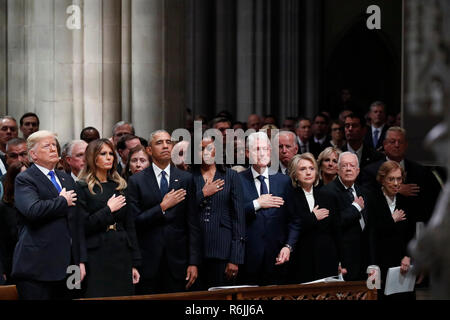 From left, President Donald Trump, first lady Melania Trump, former President Barack Obama, former first lady Michelle Obama, former President Bill Clinton, former Secretary of State Hillary Clinton, and former President Jimmy Carter and former first lady Rosalynn Carter participate in the State Funeral for former President George H.W. Bush, at the National Cathedral, Wednesday, Dec. 5, 2018 in Washington.  Credit: Alex Brandon / Pool via CNP | usage worldwide - Stock Photo
