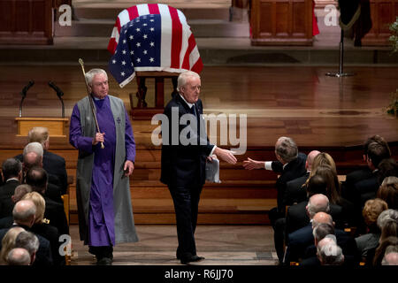 Former Canadian Prime Minister Brian Mulroney, center, shakes hands with former President George Bush, right, after speaking during the State Funeral for former President George H.W. Bush at the National Cathedral, Wednesday, Dec. 5, 2018, in Washington.  Credit: Andrew Harnik / Pool via CNP | usage worldwide - Stock Photo