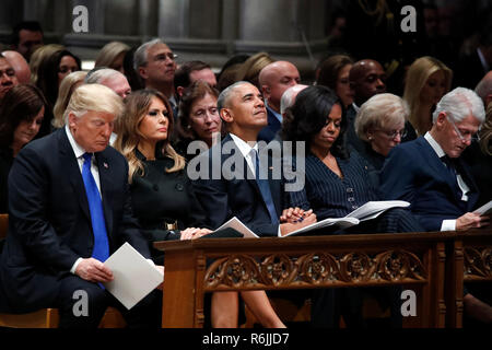 From left, President Donald Trump, first lady Melania Trump, former President Barack Obama, Michelle Obama, and former President Bill Clinton listen during a State Funeral at the National Cathedral, Wednesday, Dec. 5, 2018, in Washington, for former President George H.W. Bush. Credit: Alex Brandon/Pool via CNP | usage worldwide - Stock Photo