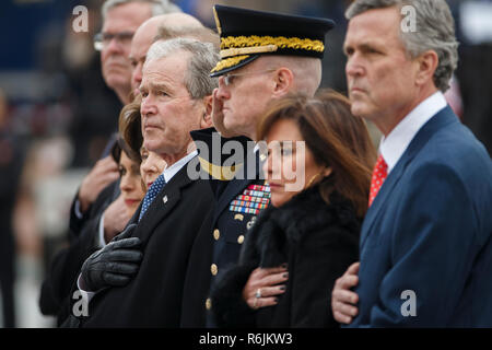 Former US President George W Bush and members of the Bush family watch as a joint service honor guard carries the casket of former US President George H.W. Bush out of the  US Capitol in Washington, DC, USA, 05 December 2018. George H.W. Bush, the 41st President of the United States (1989-1993), died at the age of 94 on 30 November 2018 at his home in Texas. Credit: Shawn Thew / Pool via CNP / MediaPunch - Stock Photo