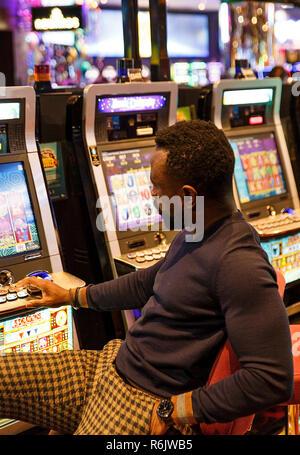 Melbourne, Australia-October 18, 2018: Man plays in Melbourne casino, Australia. - Stock Photo