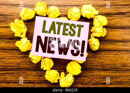 Word, writing Latest News. Business concept for Fresh Current New Story written on sticky note paper on the wooden background. - Stock Photo