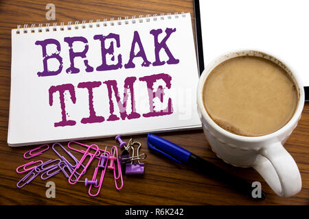Hand writing text caption inspiration showing Break Time. Business concept for Stop Pause From Work Workshop written on note paper on the wooden background with coffee and pen - Stock Photo