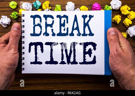 Writing text showing Break Time. Business concept for Stop Pause From Work Workshop written on notepad notebook book on the wooden wood background with man businessman hand and finger. - Stock Photo