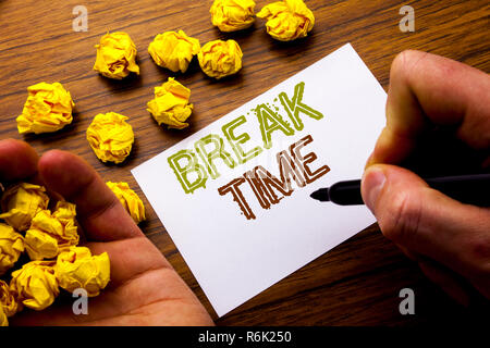 Word, writing Break Time. Concept for Stop Pause From Work Workshop written on notebook note paper on the wooden background with folded paper meaning thinking for idea. Man hand and marker. - Stock Photo