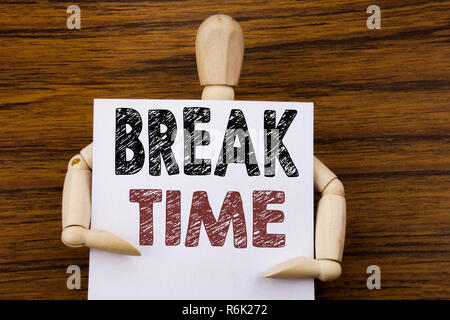 Conceptual hand writing text caption inspiration showing Break Time. Business concept for Stop Pause From Work Workshop written on sticky note paper on the wooden background. Holding by the sculpture. - Stock Photo