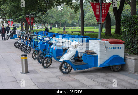 Row of electric tricycles for street cleaners in Shanghai - Stock Photo
