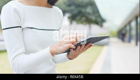 Woman use of tablet computer - Stock Photo