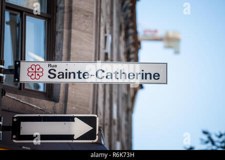 MONTREAL, CANADA - NOVEMBER 4, 2018: Street sign indicating Rue Sainte Catherine Street in Montreal, Quebec. Located in tdowntown, it is one of the mo - Stock Photo
