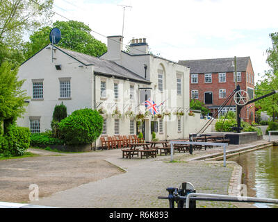 Canalside pub on the Shropshire Union canal in England. View from the boat. - Stock Photo