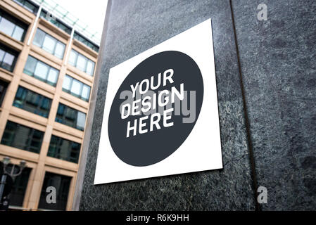 Mockup of signboard on the wall of the building on city street. Mockup could be used for presenting logotypes of shops, barber shops, bars, restaurant - Stock Photo