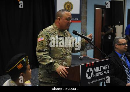 Brig. Gen. Jose R. Burgos, deputy commander of the 99th Regional Support Command, welcomes approximately 300 veterans, service members and military spouses in attendance during Hiring Our Heroes job fair held at the Community Club, on Fort Buchanan, May 18th.