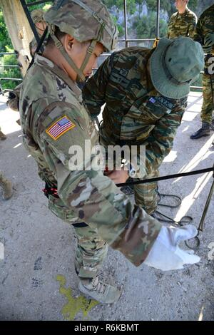 Greek paratroopers with 1st Paratrooper Commando Brigade, Greek Army conduct rappelling training for Sky Soldiers from B Company, 1st Battalion, 503rd Infantry Regiment, 173rd Airborne Brigade, May 20, 2017 in Camp Rentina, Greece as a part of Exercise Bayonet Minotaur 2017. Bayonet-Minotaur is a bilateral training exercise between U.S. Soldiers assigned to 173rd Airborne Brigade and the Greek Armed Forces, focused on enhancing NATO operational standards and developing individual technical skills. - Stock Photo