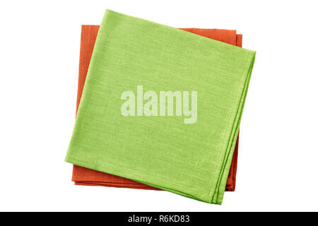 Stack of pale green and red folded napkins isolated on white background - Stock Photo