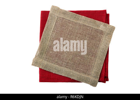 Stack of folded red and jute napkins on white - Stock Photo