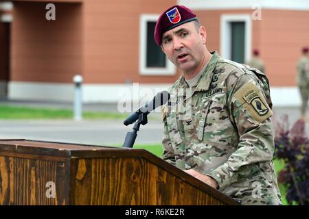 U. S. Army Paratrooper Col. Gregory K. Anderson, commander of the 173rd Airborne Brigade, speaks during the Change of Command Ceremony for 2nd Battalion, 503rd Infantry Regiment at Caserma Del Din in Vicenza, Italy, May 24, 2017. The 173rd Airborne Brigade, based in Vicenza, Italy, is the Army Contingency Response Force in Europe, and is capable of projecting forces to conduct the full of range of military operations across the United States European, Central and Africa Commands areas of responsibility. - Stock Photo