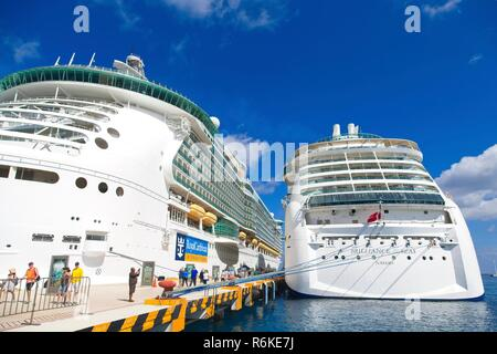 Tourists debarking Two Royal Caribbean Ships  docked in Cozumel, Mexico - Stock Photo