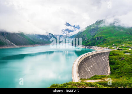 Mooserboden reservoir with hydro power station located at high mountains in Austrian Alps - Stock Photo