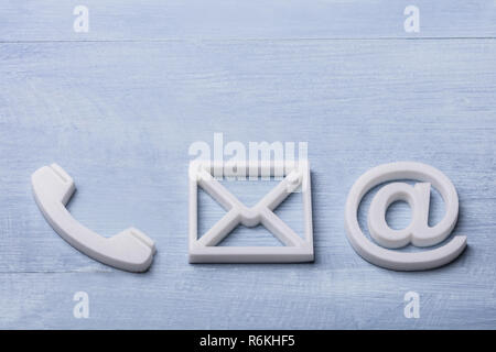 High Angle View Of Phone, Email and Post Icons - Stock Photo