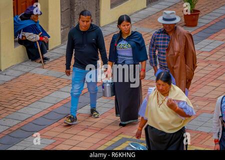 COTACACHI, ECUADOR, NOVEMBER 06, 2018: Unidentified people walking in the sidewak, of the city of Cotacachi, Ecuador - Stock Photo