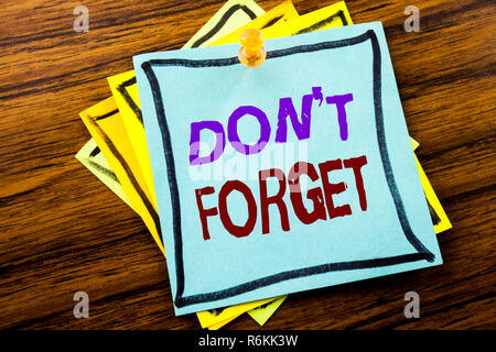 Writing text showing Do Not Forget. Business concept for Don t memory Remider written on sticky note paper on the wooden background. - Stock Photo