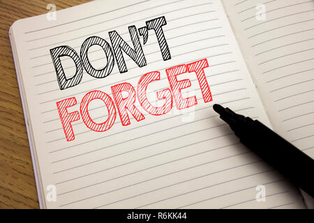 Handwriting Announcement text showing Do Not Forget. Business concept for Don t memory Remider written on notebook with copy space on book background with marker pen - Stock Photo