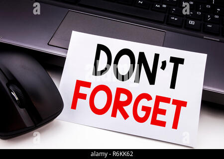Conceptual hand writing text caption inspiration showing Do Not Forget. Business concept for Don t memory Remider written on sticky note paper on the black keyboard background.