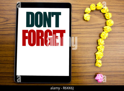 Word, writing Do Not Forget. Business concept for Don t memory Remider Written on tablet, wooden background with question mark on the end. - Stock Photo