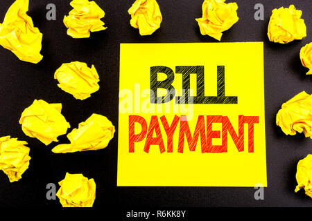 Conceptual hand writing text showing Bill Payment. Business concept for Billing Pay Costs written on sticky note paper. Folded yellow papers on the background - Stock Photo