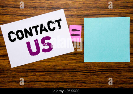 Handwriting Announcement text showing Contact Us. Business concept for Customer Support written on sticky note paper on wooden background. Equation mathematical sign for your space - Stock Photo