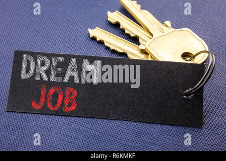 Handwritten text showing Dream Job. Business concept writing for Dreaming About Career Written on note paper attached to the key, black background with space close up - Stock Photo