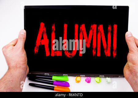 Alumni Former Students text written on tablet, computer in the office with marker, pen, stationery. Business concept for Celebration Education Ending white background with copy space - Stock Photo