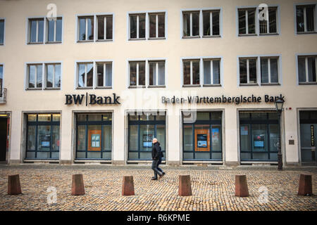 Freiburg im Breisgau, Germany - December 31, 2017: people walking in front of a branch of the German bank BW Bank on a winter day - Stock Photo