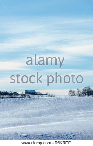 Farm fields covered with the first snow of winter on the Oak Ridges Moraine near Port Perry in Ontario Canada - Stock Photo