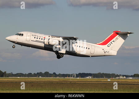 Irish CityJet Avro RJ85 with registration EI-RJT just airborne at Amsterdam Airport Schiphol. - Stock Photo
