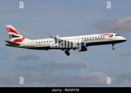 BA CityFlyer Embraer ERJ-190 with registration G-LCYR on short final for runway 06 of Amsterdam Airport Schiphol. - Stock Photo